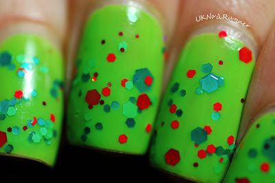 Bright lime green #Nail polish with hexagonal glitter in various sizes in red, lime green and emerald green. #Manicure Ideas – Beauty Works London