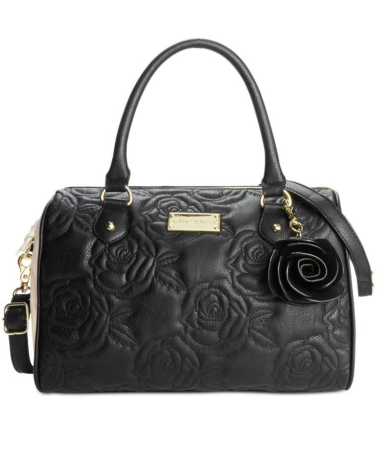 Supple and spacious with two ways to carry, this Betsey Johnson rose-quilted…