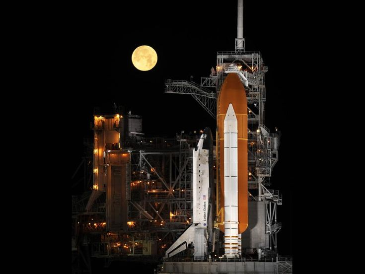 Goodnight MoonThe space shuttle Discovery stands ready for liftoff at Launch Pad 39A at NASA's Kennedy Space Center in Cape Canaveral, Fla. Behind the shuttle, a nearly full moon sets. Discovery is poised to launch on the STS-119 mission in March 2009. Credit: NASA/Bill Ingalls