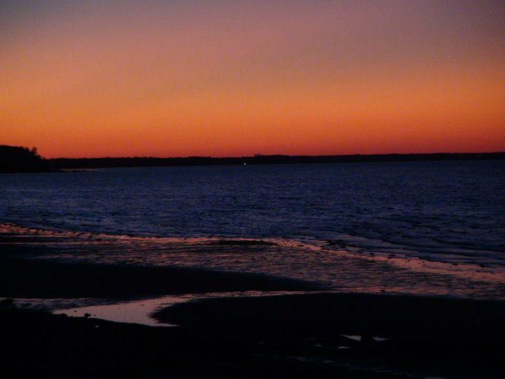 What a sunset on a beautiful sandy beach. www.bythesearentals.ca