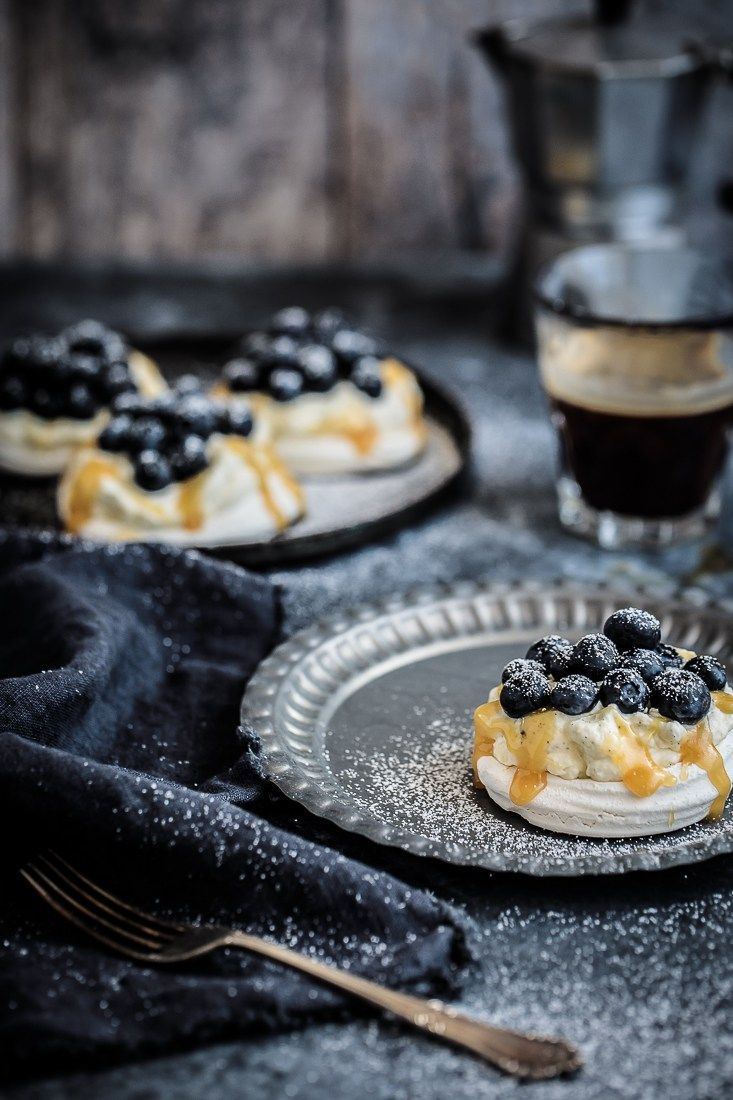 Thick vanilla bean cream topped with salted caramel and fresh blueberries, a simple but killer way to spruce up the ol' pav! Food Styling | Food Photography | Dark Food Photography | Moody | Anisa Sabet | The Macadames