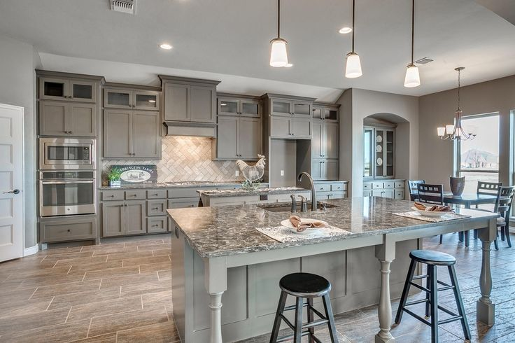 Country Kitchen with Glass panel, Caledonia Granite Countertop, Complex granite counters, Herringbone Tile, Breakfast bar
