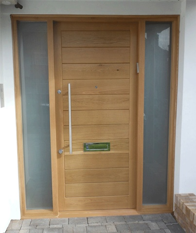 Bespoke external oak door with two sidelights. Solid European Oak with clear exterior finish #bespokedoors