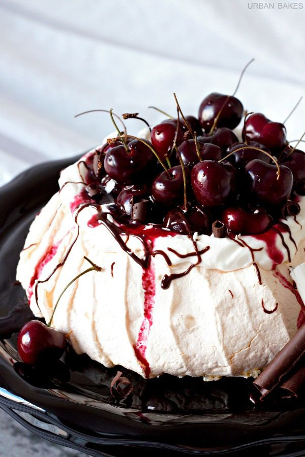 Black Forest Pavlova _ Tart red cherry compote with drizzled dark chocolate, and white chocolate shavings topped over a lightly sweetened, airy, merengue-like cake is the perfect treat.