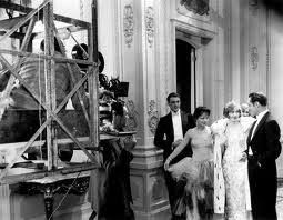 "Frank Lloyd (beneath camera) directing Gary Cooper, Clara Bow, Esther Ralston and Einar Hanson in ""Children of Divorce"" (1927)"