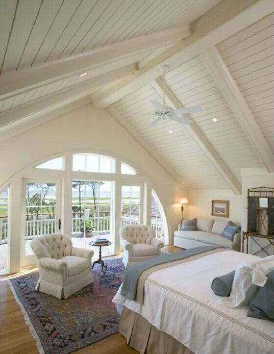 Love this attic master suite with the A frame ceiling leading out to terrace and love the rounded window/door