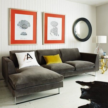 Grey velvet L-shaped sofa / Graham & Green