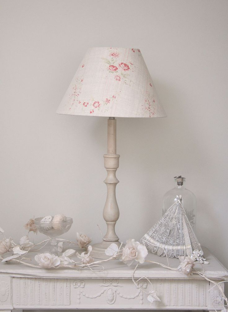 Bella empire shade. Pretty faded vintage florals work so well with antique creams and whites in the bedroom. Such an elegant decor choice.