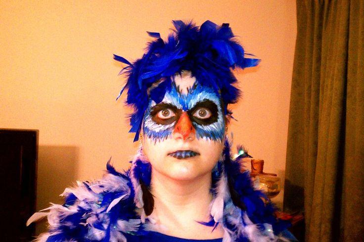 like the feathery Zazu Face Paint and headdress (put blue feathers or even blue lei on a headband)