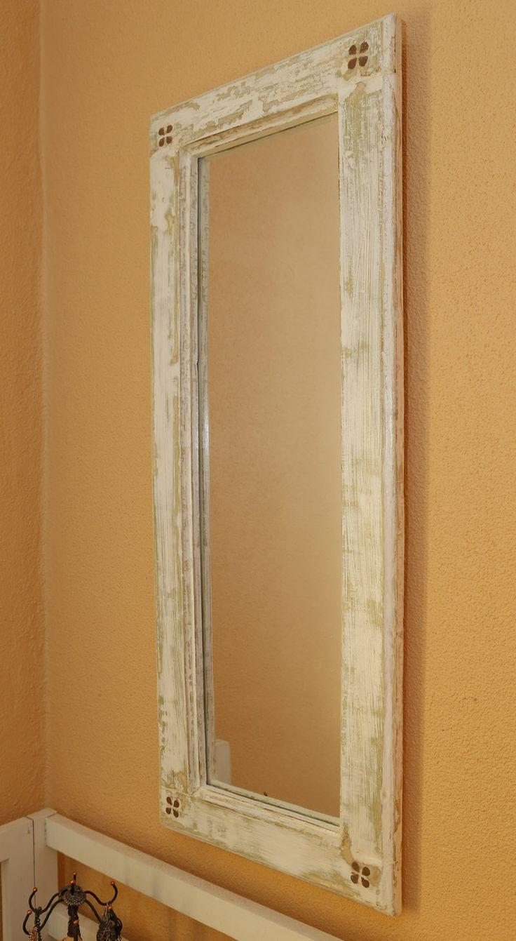 Aplicação do espelho feito com uma janela recuperada.