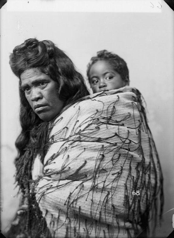 New Zealand, Maori Woman Vintage ~ Unidentified Maori woman with child and tag cloak