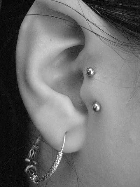 Right Ear Silver Barbell Vertical Tragus Piercing