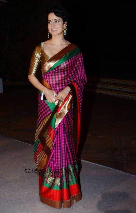 Kangana Ranaut in Manish Malhotra saree at a wedding reception in Mumbai. Kangana ranaut latest photos in checkered saree wide neck silk blouse.