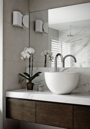 Love the marble on dark wood pairing, wall to wall mirror and tiles.