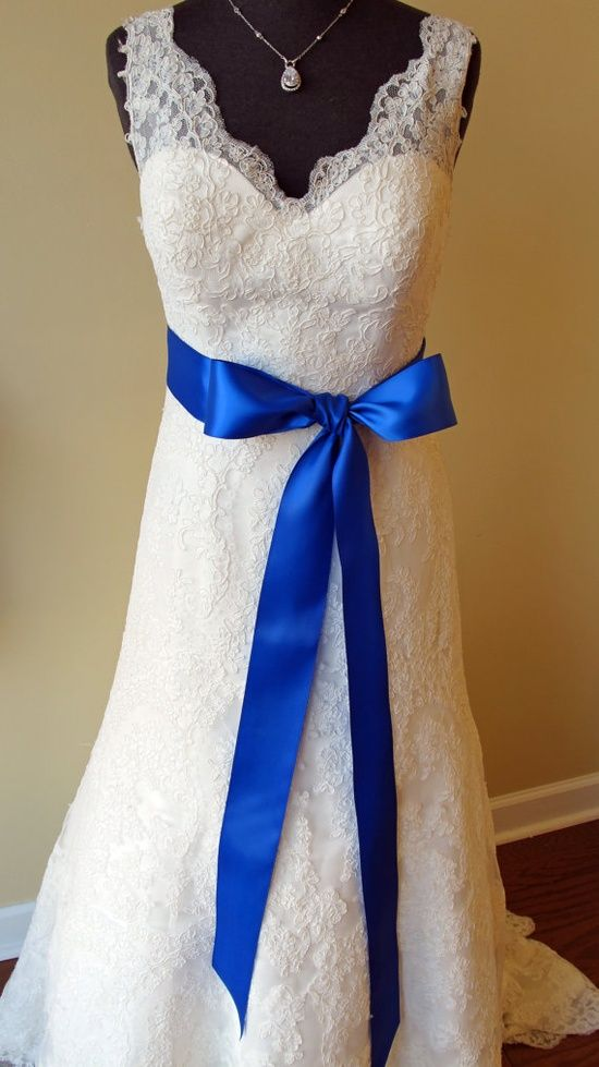 Add a Satin Royal Blue Ribbon to your Wedding Dress to incorporate your wedding color into your outfit. #royalbluewedding #weddingdress