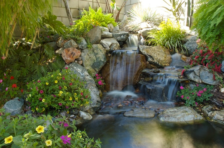 Built by the pond digger waterfalls man made for Koi pond maker
