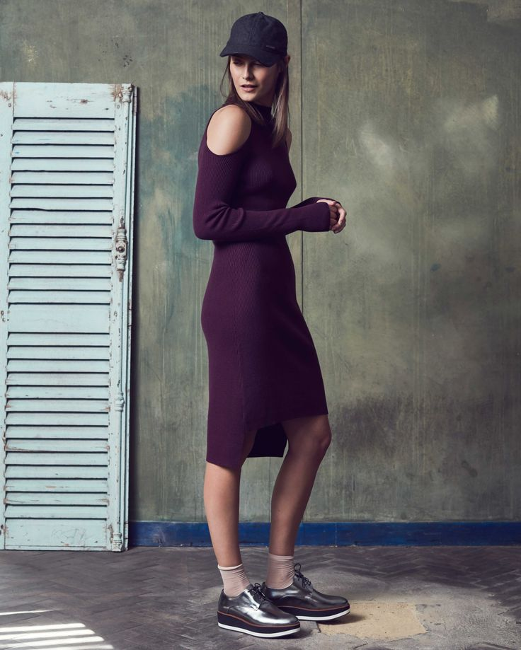 Score a wardrobe win no matter the occasion in this high neck knit dress. Crafted in a soft ribbed wool blend with a slim fit, the cut-out shoulders and knee length add a 90s vibe. Layer over leggings or wear alone, this is a piece made to standout.