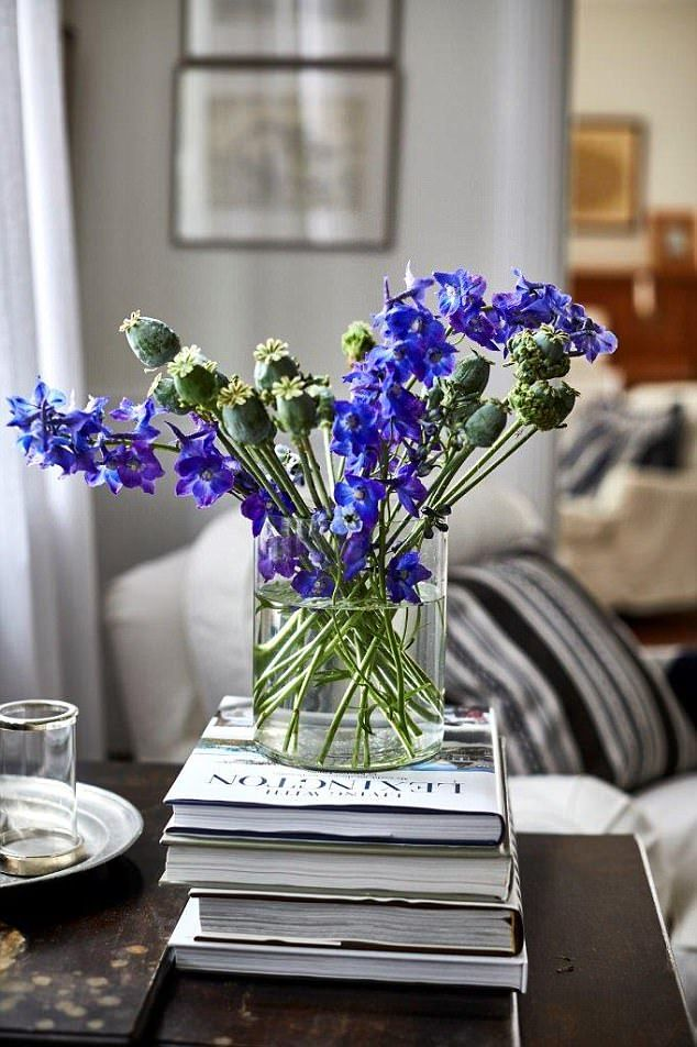 During winter Kristina likes to brighten the rooms with flowers. Her book, Living With Lexington, is a coffee-table staple. 'I'm so proud of the Lexington journey and the book took years to compile'
