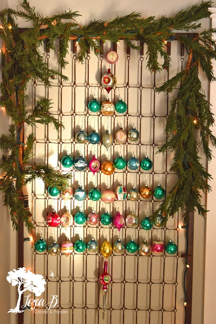 I've seen this idea on Pinterest, and decided since I had just hung this perfectly patinaed crib spring on my freshly painted dining room wall, and wanted to display my Shiny Brites everywher…