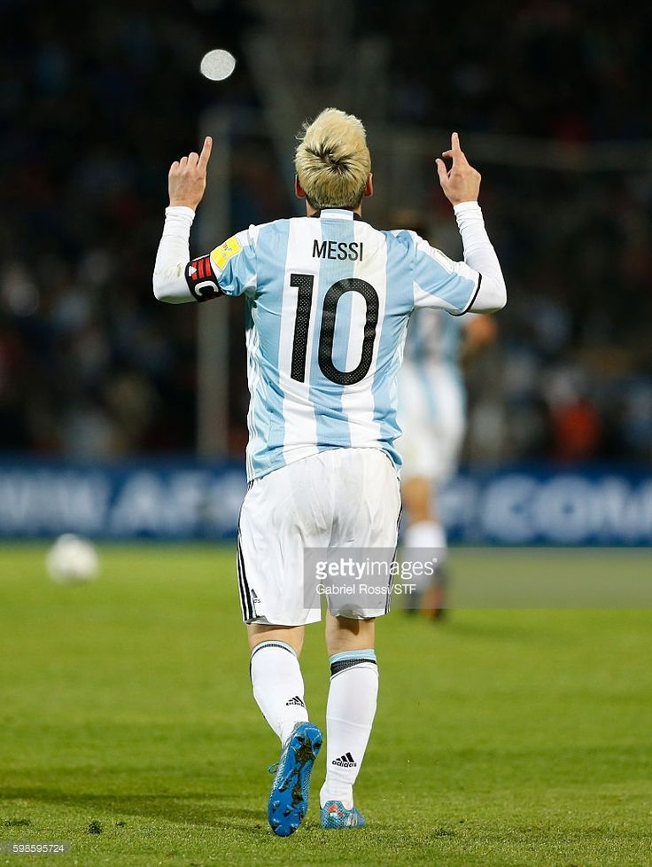 Lionel Messi of Argentina celebrates after scoring the first goal of his team…