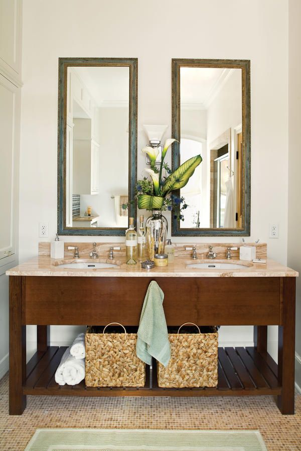 Hide Clutter with Baskets - 65 Calming Bathroom Retreats - Southernliving. If you have open shelves, use large baskets to corral small toiletries and accessories. Here, each sink has its own dedicated bin to keep his-and-hers from getting jumbled together.  Take a Virtual Tour of this Mississippi Home