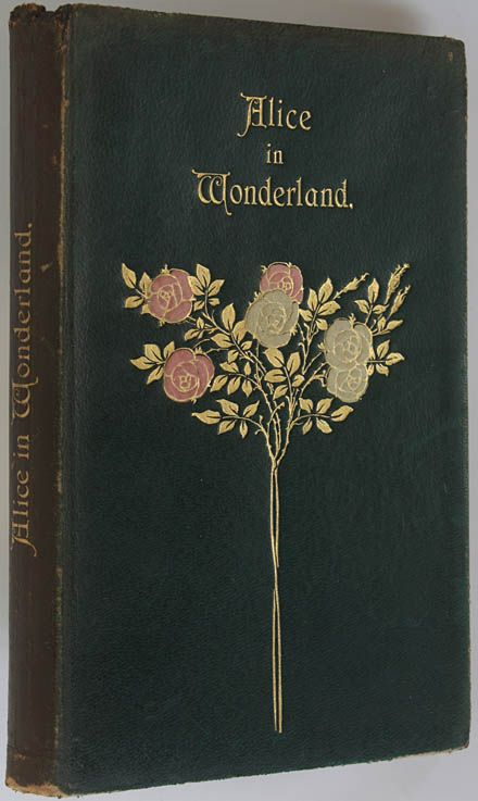 Book cover Alice in Wonderland. There are various covers for this story; this one has a delicate illustration with gold, red and white roses. Quite antique looking.