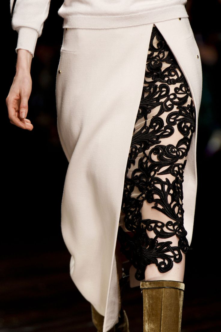 Stunning skirt split detail with contrasting black embroidered lace peeping through - Marios Schwab Fall 2013