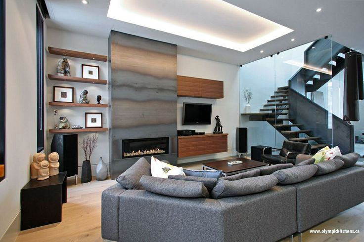The perfect contemporary man cave! Features include: Custom Walnut cabinets, floating shelves, gas fireplace and hardwood flooring. www.olympickitchens.ca