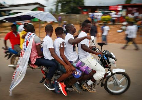 Buchanan, LiberiaSupporters of presidential candidate George Weah ride five to a motorcycle during a campaign rally before Liberians head to the polls on 10 October