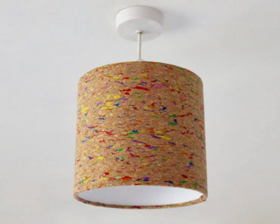Bellissimo! A lampshade handmade from exquisitely textured cork fabric sourced from one of the fashion capitals of the world, Italy! This intriguing material, created for the fashion industry and crated into a stylish lampshade, is sure to be the talking point in any room in your home!  Cork is harvested from the bark of the oak tree and considered an eco-friendly and sustainable material as the tree is unharmed in its production. This modern, paint-speckled pattern cork material has been…