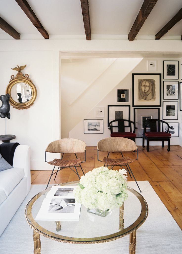 Tour an eclectic sag harbor cottage neutral living rooms for Table in living room