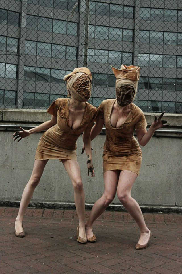 Great Silent Hill cosplay.// I've always seen these guys at cons and they creep me out so much