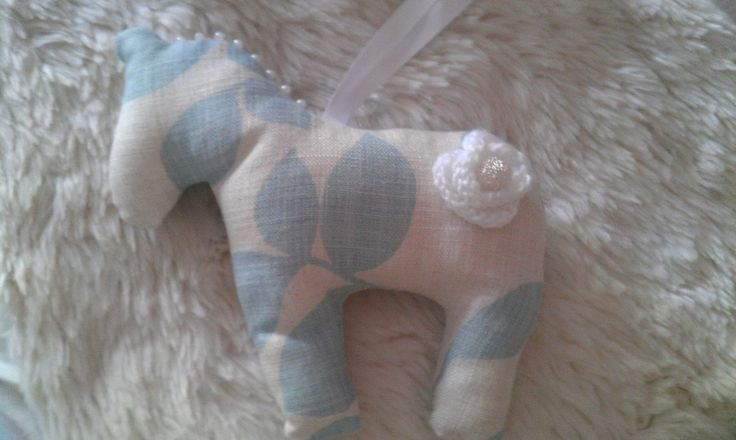 Gorgeous handmade duck egg blue horse with pearl plaits and knitted flower.