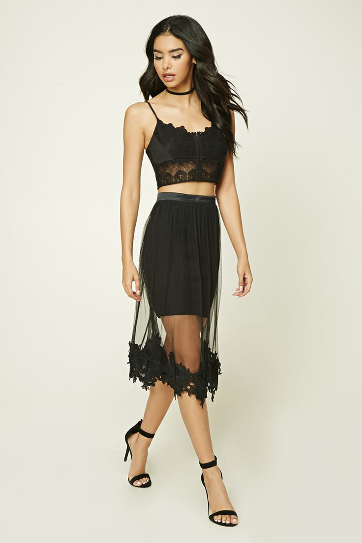 A semi-sheer tulle skirt featuring a floral-shaped crochet trim, concealed back zipper, and a satin waist.