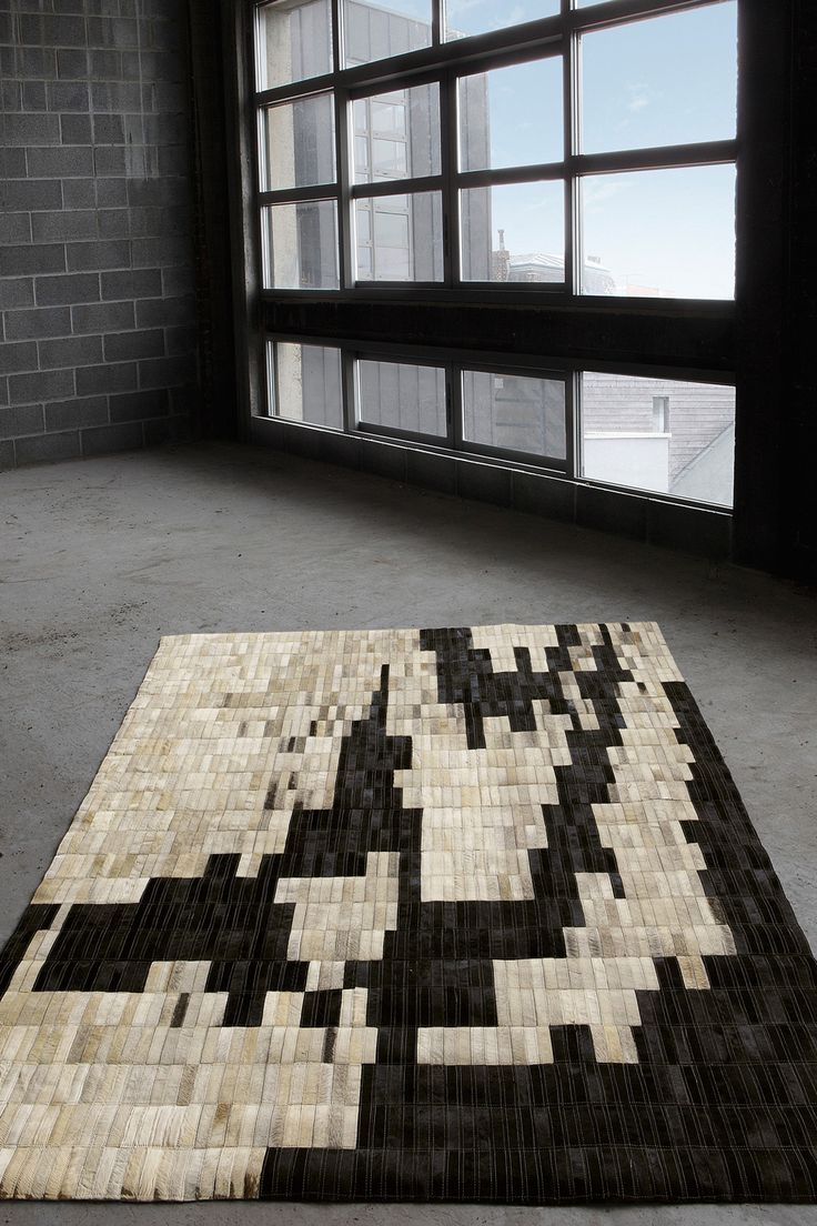 DALEVILLE Collection An ideal style for lofts, this rug plays around with rectangular shapes in black, grey and white, which fit together like a puzzle, to create the most contemporary interiors!