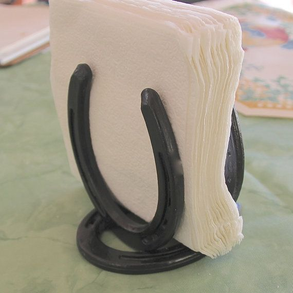 Classic horseshoe paper napkin holder, made from clean, new horseshoes, Made To Order. $15.00, via Etsy.