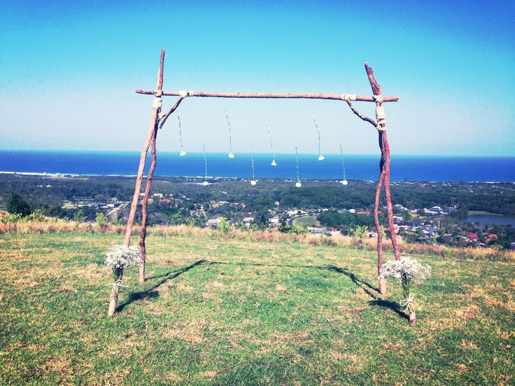 Wedding arch hand made by the grooms' sisters' boyfriend.  Amazing sea views from a Bangalow mountain