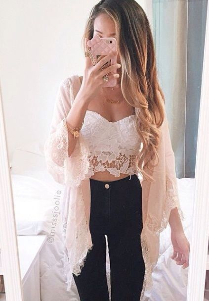 Strapless white lace crop top, high waisted black jeans and a pale pink kimono