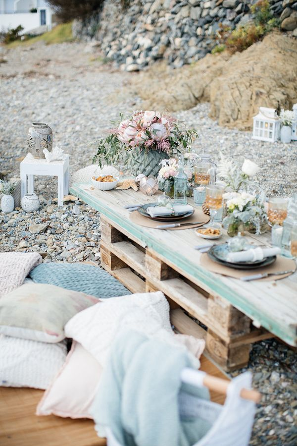 beach tablescape - photo by Charlotte van den Berg http://ruffledblog.com/spanish-bohemian-beach-inspiration