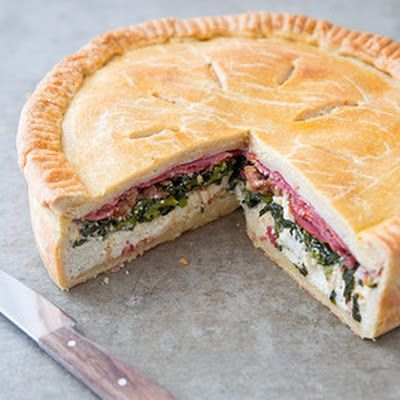 Made to feed a crowd, Italian Easter pie is a hefty construction of meats and cheeses wrapped in a pastry crust. Sautéed broccoli rabe adds freshness and a touch of bitterness, and it wouldn't be Italian without garlic.