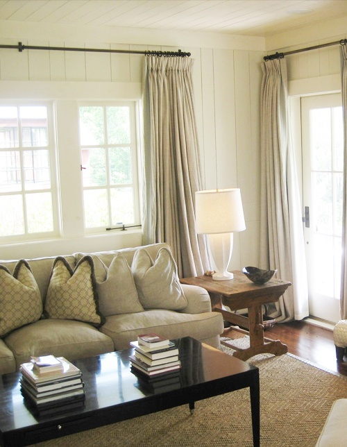 Similar to what we want for our sun room (also known as the catarium b/c that's where our cats spend most of their time). ;-) I love the cream walls and neutral rug and curtains.