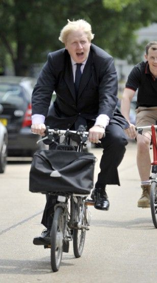 The ultimate city cyclist, Mayor of London                         Boris Jonhson                         , cycles in his suit as he road-tes...