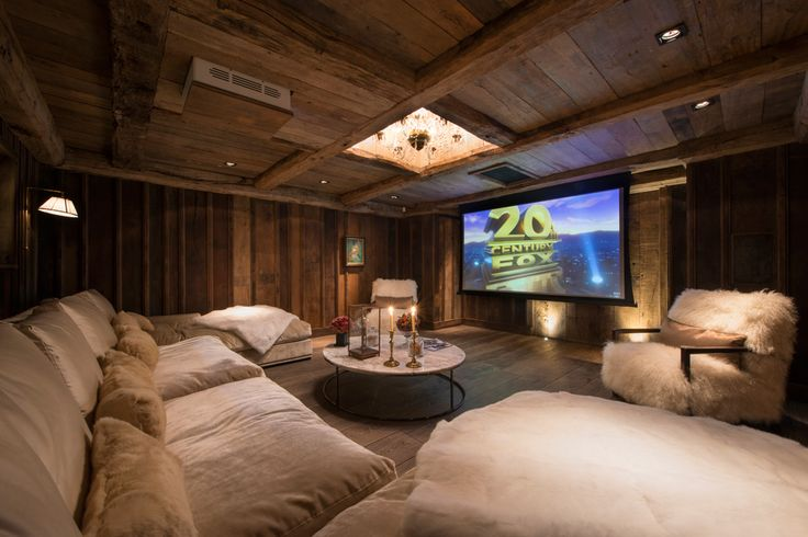 Home Theater in a Chalet- love the inset chandelier!