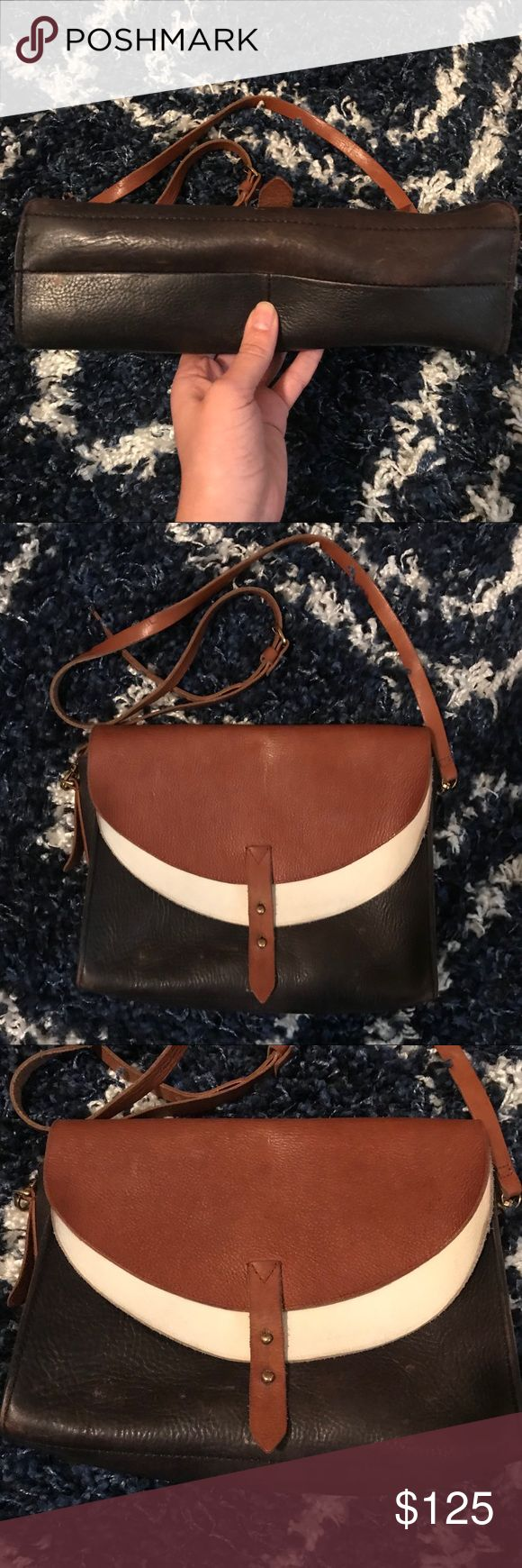 "{Madewell} Essex Colorblock Crossbody Great classic Madewell Bag. Discontinued style. Brown, white, dark navy blue leather.   In good used condition. Some fading & wear on the navy portion & at the top of the white flap (transfer from brown strap & not seen when closed). There's also a little stain of a sort in the center of the main compartment. Not sure what it is—was there when I purchased from another buyer. Tons of life left! Treated with leather weather guard.   11""W x 8.5""H x 3.5""D…"