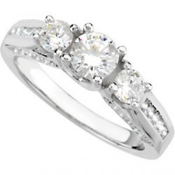 If your bride to be likes a lot of sparkle and fire, she will love this 1.1 ct. total weight diamond ring in 14K white gold. The ring has a .4 Ct. Round Cut center of very good quality diamond, two Round Cut, .2 carat side diamonds of similar quality and 36 Round Cut accent diamonds – all at a sensational price. A wedding band is also available, but is priced separately.