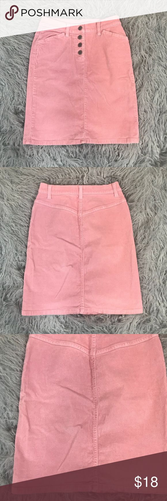 """Vintage 90s United Colors Of Benetton Mini Skirt In good vintage condition. Small flaw on front of skirt. It is shown in close up picture where I am pointing. Pink corduroy. 4 button down buttons. No stretch! High rise fit. Made in Italy. Size 40. Measures as a size 24. Please refer to measurements to ensure a proper fit.  Waist: 12"""" Length: 18"""" United Colors Of Benetton Skirts Mini"""