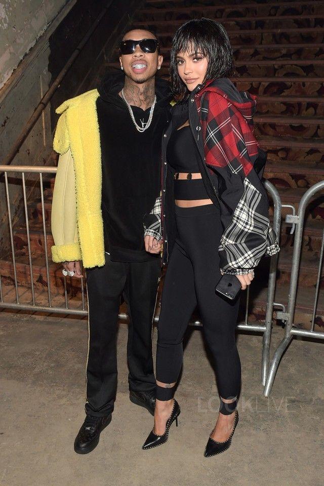 Tyga wearing  Needles Track Pants, Nike Air Force 1 Low Sneakers, Yeezy Season 3 Shearling Coat