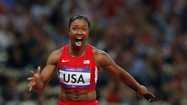 Carmelita Jeter of the United States celebrates winning gold in the women's 4 x 100m Relay Final on Day 14 of the London 2012 Olympic Games at Olympic Stadium.