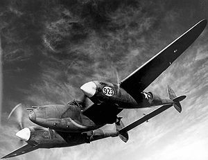 """The Lockheed P-38 Lightning was a World War II American fighter aircraft built by Lockheed. Developed to a United States Army Air Corps requirement, the P-38 had distinctive twin booms and a single, central nacelle containing the cockpit and armament. Named """"fork-tailed devil"""" by the Luftwaffe and """"two planes, one pilot"""" by the Japanese, the P-38 was used in a number of roles, including dive bombing, level bombing, ground-attack, 1939 wem"""