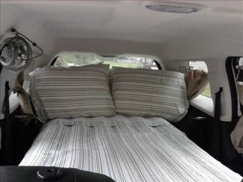 ▶ Jeep Patriot Camper - YouTube  -Roll down windows, use magnets and screen for bug protection -Fold down passenger seat and all back seats -Put in blow up mattress, blankets, pillows -Plug fan in center console -Watch dvd's on your dvd screen!  -Enjoyy